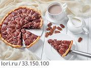 Купить «pecan pie sliced on a white platter», фото № 33150100, снято 19 ноября 2019 г. (c) Oksana Zh / Фотобанк Лори