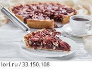 Купить «close-up of a slice of delicious pecan pie», фото № 33150108, снято 19 ноября 2019 г. (c) Oksana Zh / Фотобанк Лори
