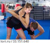 Active girl training captures on the self-defense course. Стоковое фото, фотограф Яков Филимонов / Фотобанк Лори