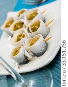 Купить «Herring rolls with stuffed olives», фото № 33151756, снято 3 апреля 2020 г. (c) Яков Филимонов / Фотобанк Лори