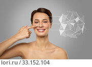 Купить «beautiful woman pointing finger to face skin», фото № 33152104, снято 30 ноября 2019 г. (c) Syda Productions / Фотобанк Лори