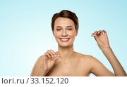 Купить «happy young woman with dental floss cleaning teeth», фото № 33152120, снято 30 ноября 2019 г. (c) Syda Productions / Фотобанк Лори