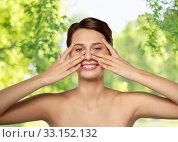 Купить «beautiful young woman touching her face», фото № 33152132, снято 30 ноября 2019 г. (c) Syda Productions / Фотобанк Лори