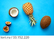 pineapple, passion fruit and coconut on blue. Стоковое фото, фотограф Syda Productions / Фотобанк Лори