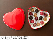 Купить «candies in red heart shaped chocolate box», фото № 33152224, снято 1 февраля 2019 г. (c) Syda Productions / Фотобанк Лори