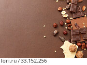 Купить «chocolate bars with hazelnuts and cocoa beans», фото № 33152256, снято 1 февраля 2019 г. (c) Syda Productions / Фотобанк Лори