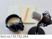 Купить «headphones, microphone and notebook with pencil», фото № 33152264, снято 17 мая 2019 г. (c) Syda Productions / Фотобанк Лори