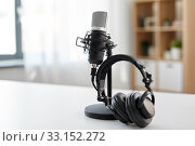 Купить «headphones and microphone at home office», фото № 33152272, снято 17 мая 2019 г. (c) Syda Productions / Фотобанк Лори
