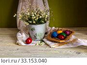 Купить «The easter composition with eggs and candles», фото № 33153040, снято 26 апреля 2019 г. (c) Татьяна Ляпи / Фотобанк Лори