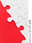 Купить «Blank white jigsaw puzzles on a bright red paper background», фото № 33157696, снято 28 февраля 2020 г. (c) PantherMedia / Фотобанк Лори