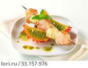 Chicken and aubergine skewer with pesto and horned melon. Стоковое фото, фотограф Alena Dvorakova / PantherMedia / Фотобанк Лори