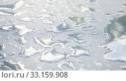 Купить «Water drops are on a white plastic fabric surface», фото № 33159908, снято 5 января 2020 г. (c) EugeneSergeev / Фотобанк Лори
