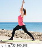 Купить «Smiling young woman doing exercises», фото № 33160208, снято 20 февраля 2020 г. (c) Яков Филимонов / Фотобанк Лори