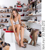 Купить «female is trying on summer shoes», фото № 33160272, снято 17 августа 2017 г. (c) Яков Филимонов / Фотобанк Лори