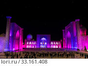 View of Registan square in Samarkand with Ulugbek madrassas, Sherdor madrassas and Tillya-Kari madrassas at night during the color show. Uzbekistan (2019 год). Редакционное фото, фотограф Наталья Волкова / Фотобанк Лори