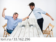 Купить «Business conflict. The two men expressing negativity while one man grabbing the necktie of her opponent», фото № 33162296, снято 3 июля 2020 г. (c) PantherMedia / Фотобанк Лори