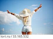 Купить «Rear view of female with outstretched arms enjoying life», фото № 33165532, снято 27 февраля 2020 г. (c) PantherMedia / Фотобанк Лори