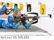 Купить «Sportswoman biathlete Legostaeva Anastasia rifle shooting in prone position. Biathlete in shooting range. Junior biathlon competitions East Cup. Kamchatka Peninsula», фото № 33165692, снято 12 апреля 2019 г. (c) А. А. Пирагис / Фотобанк Лори