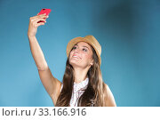 Купить «technology and internet. happy woman using cellphone texting on mobile phone. teen girl reading sms on smartphone,taking selfie on blue», фото № 33166916, снято 31 мая 2020 г. (c) PantherMedia / Фотобанк Лори