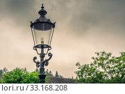 Купить «Vintage street lamp in cloudy weather», фото № 33168208, снято 31 мая 2020 г. (c) PantherMedia / Фотобанк Лори