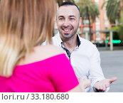 Купить «Young male is flirting with girl», фото № 33180680, снято 18 октября 2017 г. (c) Яков Филимонов / Фотобанк Лори