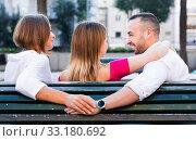 Купить «Image of the love triangle between young people outdoor.», фото № 33180692, снято 18 октября 2017 г. (c) Яков Филимонов / Фотобанк Лори