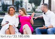 Купить «Girlfriends are rejecting stranger man who wants acquintance with them», фото № 33180696, снято 18 октября 2017 г. (c) Яков Филимонов / Фотобанк Лори