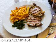 Купить «Grilled cutlet with French fries», фото № 33181104, снято 4 апреля 2020 г. (c) Яков Филимонов / Фотобанк Лори