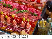 Купить «Cold cuts from Spanish ham, sausages, bacon», фото № 33181208, снято 29 февраля 2020 г. (c) Яков Филимонов / Фотобанк Лори