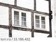 Купить «facade of a half-timbered house with window», фото № 33186432, снято 25 февраля 2020 г. (c) PantherMedia / Фотобанк Лори