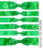 Купить «set of real bow knots on green satin ribbon», фото № 33194584, снято 27 февраля 2020 г. (c) PantherMedia / Фотобанк Лори