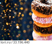 Купить «close up of glazed donuts with sprinkles», фото № 33196440, снято 21 мая 2015 г. (c) Syda Productions / Фотобанк Лори
