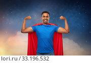 indian man in superhero cape showing his power. Стоковое фото, фотограф Syda Productions / Фотобанк Лори