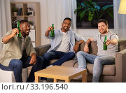Купить «happy male friends drinking beer at home at night», фото № 33196540, снято 28 декабря 2019 г. (c) Syda Productions / Фотобанк Лори