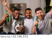 Купить «friends or soccer fans with ball and beer at home», фото № 33196572, снято 28 декабря 2019 г. (c) Syda Productions / Фотобанк Лори