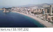 Купить «Aerial view of coast at Benidorm cityscape with a modern apartment buildings, Spain», видеоролик № 33197232, снято 17 апреля 2019 г. (c) Яков Филимонов / Фотобанк Лори