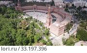 Купить «Aerial view of Plaza d'Espana with park and a bridge on ver the canal in Sevilla», видеоролик № 33197396, снято 19 апреля 2019 г. (c) Яков Филимонов / Фотобанк Лори