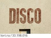 Купить «Disco label on wall», фото № 33198016, снято 26 мая 2020 г. (c) PantherMedia / Фотобанк Лори