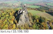 Купить «Above view of medieval castle Trosky. Czech Republic», видеоролик № 33198180, снято 18 октября 2019 г. (c) Яков Филимонов / Фотобанк Лори