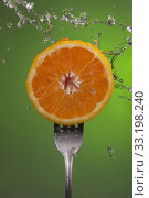 Купить «Orange fruit half fork green health concept water», фото № 33198240, снято 12 июля 2020 г. (c) PantherMedia / Фотобанк Лори