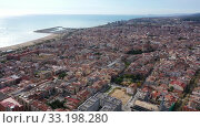 Купить «Scenic view from drone of large coastal Spanish town of Mataro on sunny winter day, Catalonia», видеоролик № 33198280, снято 24 ноября 2019 г. (c) Яков Филимонов / Фотобанк Лори