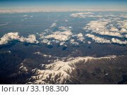 Top View from plane to snow capped peaks of Caucasus Mountains. Стоковое фото, фотограф Володина Ольга / Фотобанк Лори