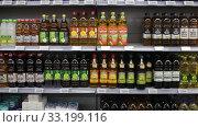Купить «Variety of olive oil on rack in supermarket», видеоролик № 33199116, снято 7 ноября 2019 г. (c) Яков Филимонов / Фотобанк Лори