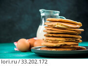 Купить «Pancakes stack pile and fresh ingredients.», фото № 33202172, снято 7 июля 2020 г. (c) easy Fotostock / Фотобанк Лори