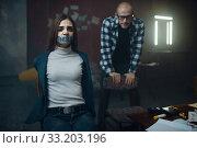 Купить «Maniac kidnapper and his victim with taped mouth», фото № 33203196, снято 13 ноября 2019 г. (c) Tryapitsyn Sergiy / Фотобанк Лори