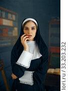 Купить «Young sexy nun in a cassock, vicious desires», фото № 33203232, снято 14 ноября 2019 г. (c) Tryapitsyn Sergiy / Фотобанк Лори