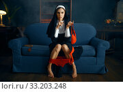 Купить «Sexy nun in cassock sitting with her panties down», фото № 33203248, снято 14 ноября 2019 г. (c) Tryapitsyn Sergiy / Фотобанк Лори