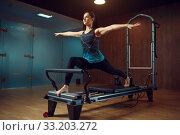 Купить «Slim girl keeps the balance, pilates training», фото № 33203272, снято 26 ноября 2019 г. (c) Tryapitsyn Sergiy / Фотобанк Лори