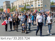 "Купить «Procession of the public movement ""Immortal regiment"" in memory of the 26 million compatriots who died in the Great Patriotic War», фото № 33203724, снято 9 мая 2016 г. (c) Наталья Волкова / Фотобанк Лори"