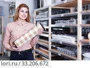 Купить «Adult salesgirl suggesting carpet for bathroom», фото № 33206672, снято 15 января 2018 г. (c) Яков Филимонов / Фотобанк Лори